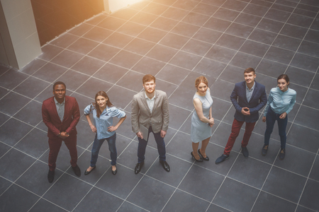 professional business team looking confidently at camera, high angle Stock Photo