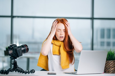Beautiful woman tired after making video