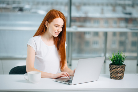 woman typing on laptop at workplace Woman working in home office hand keyboard