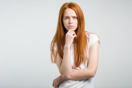 female with freckles and pursed lips having disappointed unhappy look Stock Photo