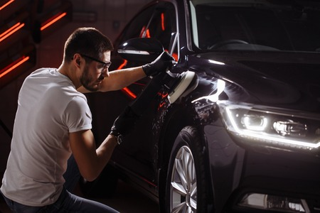 series of detailed cars: Polishing a car Stok Fotoğraf