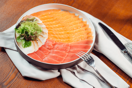 Fish carpaccio. Carpaccio of salmon on white plate. Stock Photo