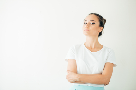 Resentful unhappy casual woman with short blond hair looking down Stock Photo