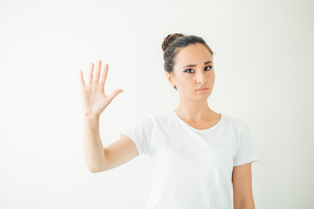 A woman making stop gesture with her hand