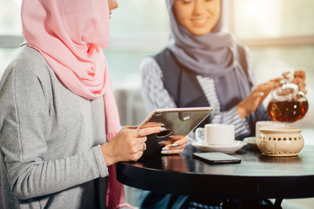 portrait of young arabic woman working with tablet Stock Photo