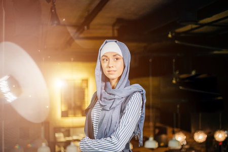 Young muslim woman in head scarf smile