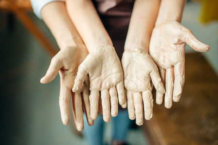 Child with mud on the hands. Stock Photo