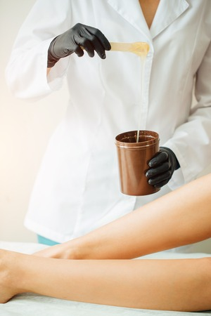 hot wax in white bowl for Hair removal Stock Photo