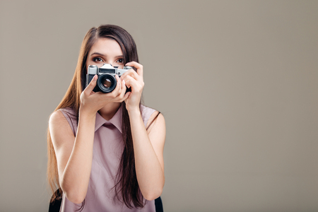 Woman photographer is taking images with dslr camera Stock Photo