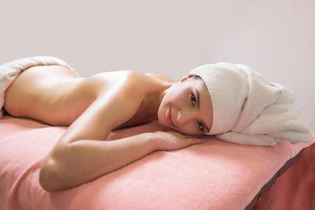 young woman enjoys massage in a spa resort