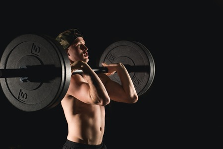 man lifting weights. muscular man workout in gym doing exercises with barbell Stock Photo