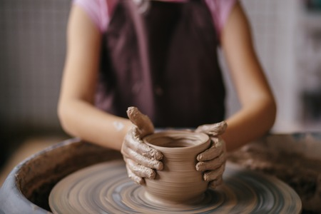 Hands of young potter, close up hands made cup on pottery wheel Reklamní fotografie - 91856219