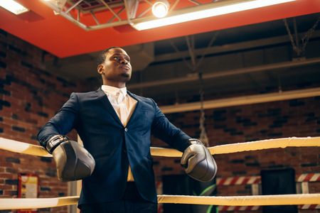 African Businessman standing posture in boxing gloves