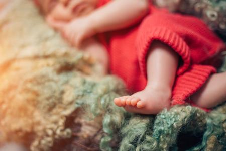 small legs of sleeping newborn baby