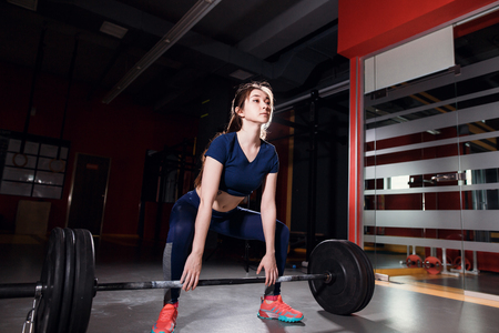 Cross fit woman in the gym