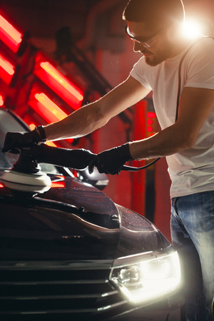 series of detailed cars: Polishing a car Stock Photo