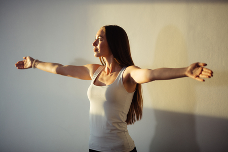 woman outstretching her arms Stock Photo