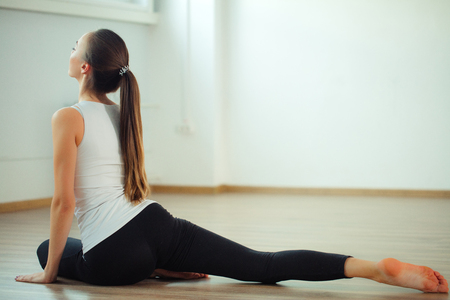woman practicing yoga pose at yoga healthy sport gym