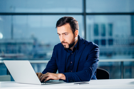 Business man or accountant working on laptop computer with business document Stock Photo