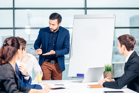 Director of company having business meeting with his staff Stock Photo