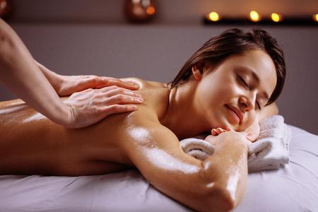 Spa body massage treatment. Woman having massage in the spa salon Stock Photo