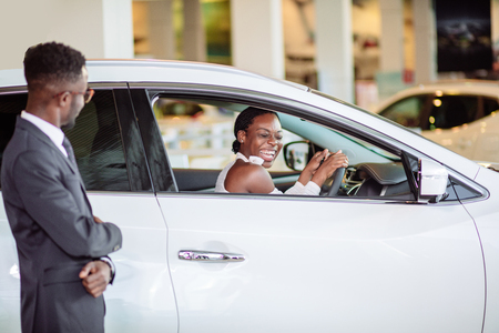 african woman surprised by new car, gift for my beautiful wife