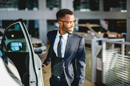 african american driver opening his new car door Stock Photo