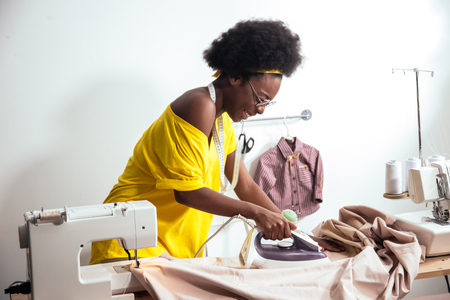 african Woman seamstress Ironing cloth Stock fotó