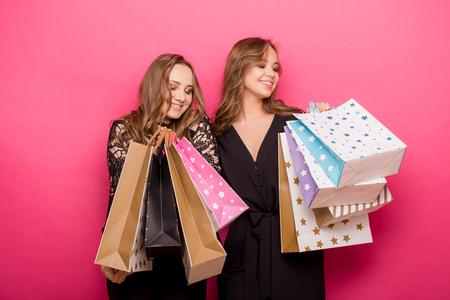 Happy friends shopping. Two beautiful women enjoying shopping