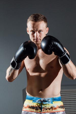 portrait of boxer in Boxing gloves on gray background