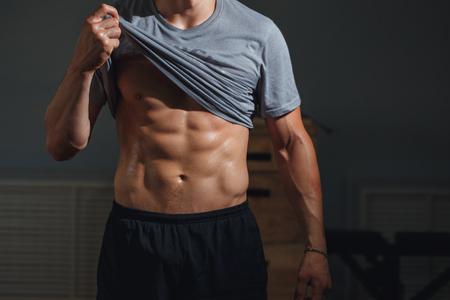 Man with muscular torso showing six pack abs Foto de archivo - 95855643