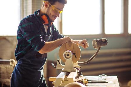 attractive man begin doing woodwork in carpentry