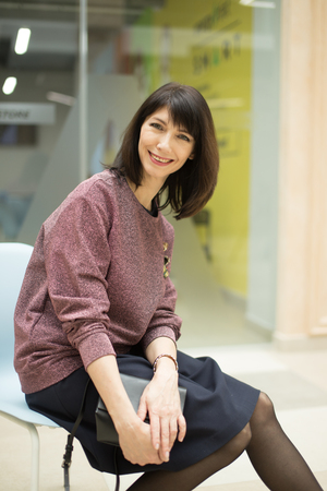 casual woman sitting on chair and relaxing in mall Stock Photo