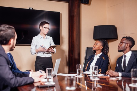 businesswomen interacting at the meeting in modern office Stock Photo