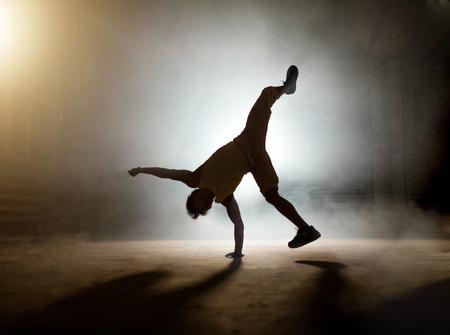 creative dancer showing stunts of hip hop