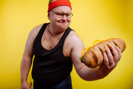 funny fat man sweats while lifting burger
