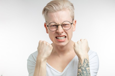 Outraged man gestures angrily, being irritated, outraged Stock Photo