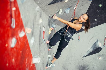 sporty woman in boulder climbing hall Stock Photo
