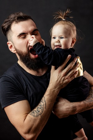 father playing with little son at home