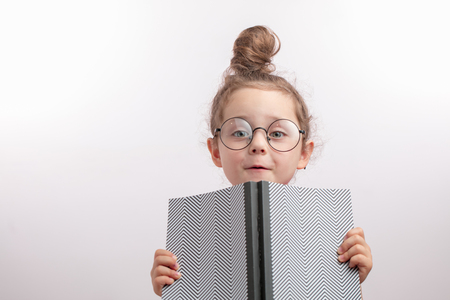 funny talented girl holding her dads notepad