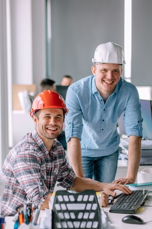 handsome smiling architects working in the office building Zdjęcie Seryjne - 106654668
