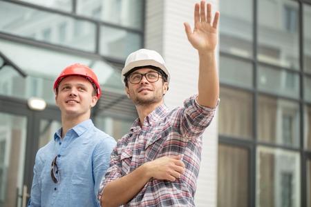 prosperous master builders waving hands
