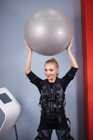 cheerful positive sportswoman working out with ball Standard-Bild