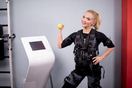 cheerful blonde in EMS suit is posing to the camera Stock Photo
