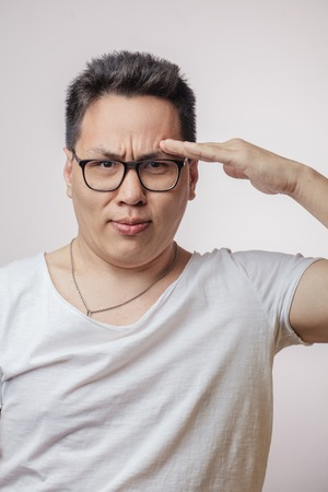 Asian man in salute pose, ready to fulfill the order.