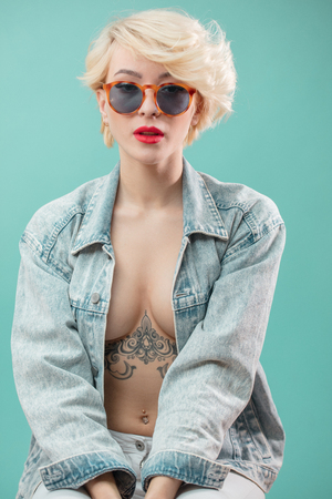 Beautiful awesome girl with stylish make-up and tattooed body Stock Photo