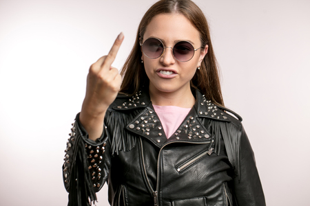 close up portrait of angry hipster woman showing middle finger Stock fotó