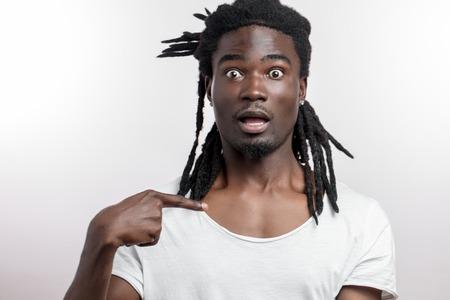 black man pointing at himself, asking Who me