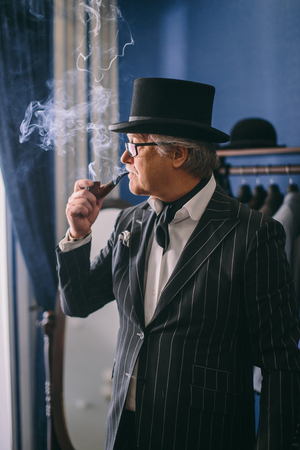 Portrait of posh mature gentleman visiting a tailors shop 写真素材