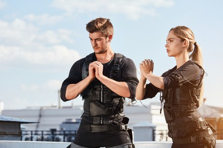 fit young people are concentrated on EMS training Stock Photo
